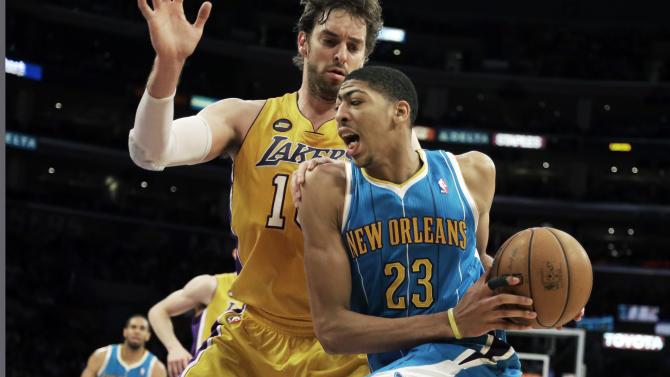 New Orleans Hornets forward Anthony Davis (23) drives against Los Angeles Lakers forward Pau Gasol (16), of Spain, in the first half of an NBA basketball game in Los Angeles Tuesday, April 9, 2013.  (AP Photo/Reed Saxon)