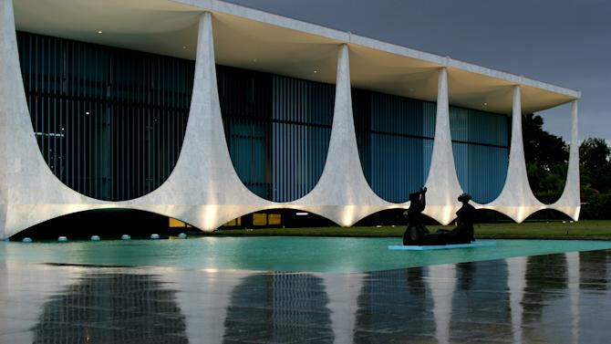 FILE - In this April 5, 2006 file photo is seen the Palacio da Alvorada, or Palace of Dawn, the official residence of Brazilian presidents which was designed by architect Oscar Niemeyer in Brasilia, Brazil. According to a hospital spokeswoman on Wednesday, Dec. 5, 2012, famed Brazilian architect Oscar Niemeyer has died at age 104.  (AP Photo/Eraldo Peres, File)