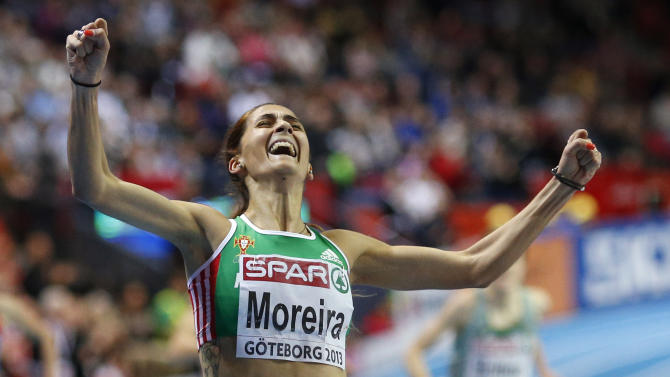 Portugal's  Sara Moreira celebrates winning the gold medal in the women's 3000m final during the Athletics European Indoor Championships in Gothenburg, Sweden, Sunday, March 3, 2013. (AP Photo/Matt Dunham)