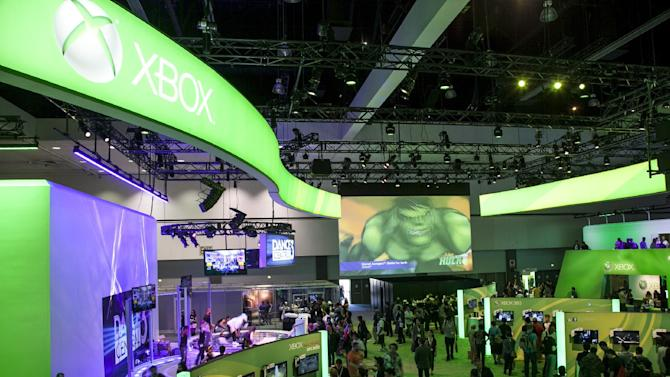 FILE - In this June 5, 2012 file photo, show attendees walk past Microsoft XBox booth at E3 2012 in Los Angeles. With the next Xbox expected to finally be revealed Tuesday, May 21, 2013, at Microsoft's headquarters in Redmond, Wash., anticipation for what the company is planning for the next iteration of its gaming console is higher than Master Chief's last spaceship. (AP Photo/Damian Dovarganes, File)