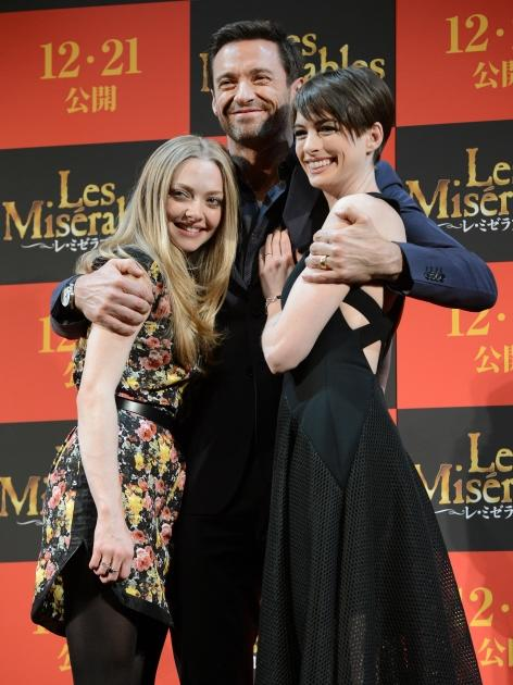 Amanda Seyfreid, Hugh Jackman and Anne Hathaway pose for photographers during an event to promote their latest movie 'Les Miserables' in Tokyo on November 28, 2012 -- Getty Images