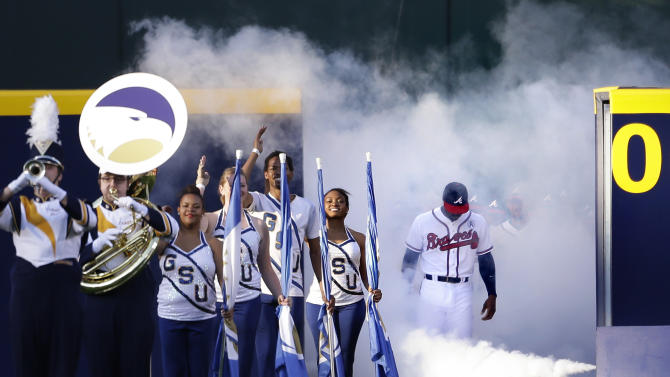 Atlanta Braves' Jason Heyward, right, leads teammates out onto the field for the start of an opening day baseball game against the Philadelphia Phillies, Monday, April 1, 2013, in Atlanta. (AP Photo/David Goldman)