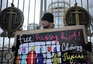 "A supporter of female Russian punk band Pussy Riot holds a poster as he pickets outside a Moscow courthouse in March. The band are on trial on hooliganism charges for barging into a landmark Moscow church in February and singing a ""punk prayer"" calling for the ousting of President Vladimir Putin"