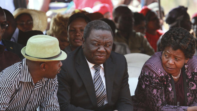 Movement For Democtratic Change (MDC) President Morgan Tsvangirai, center, attends the burial of activist Rebecca Mafukeni in Harare, Wednesday, Aug. 14, 2013. Mafukeni died while imprisoned for the alleged murder of a police officer. Tsvangirai who lost to President elect, Robert Mugabe in elections is challenging the results in court and has declared the election null and void. (AP Photo/Tsvangirayi Mukwazhi)