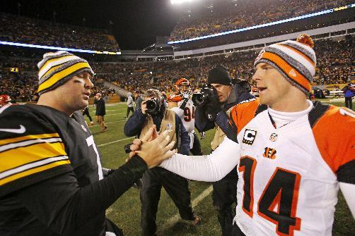 Cincinnati Bengals quarterback Andy Dalton (14) and Pittsburgh Steelers quarterback Ben Roethlisberger (7) meet on the field after an NFL football game in Pittsburgh, Sunday, Dec. 28, 2014. The Steelers won 27-17. (AP Photo/Gene J. Puskar)