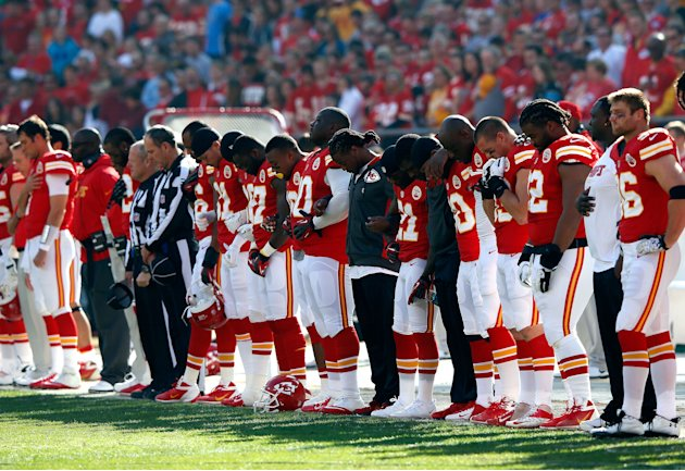 KANSAS CITY, MO - DECEMBER 02: The Kansas City Chiefs pause for a moment of silence honoring domestic abuse after the incident involving Jovan Belcher #59 prior to the game at Arrowhead Stadium on Dec