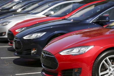 Row of Tesla Model S sedans are seen outside the company's headquarters in Palo Alto, California