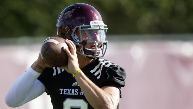 FILE - In this Aug. 5, 2013, file photo, Texas A&M quarterback Johnny Manziel throws during NCAA college football practice in College Station, Texas. Texas A&M coaches and players are talking only about Rice, their opening opponent Saturday. What they're not talking about is Manziel and the NCAA investigation into whether he was paid for autographs. (AP Photo/Patric Schneider, File)