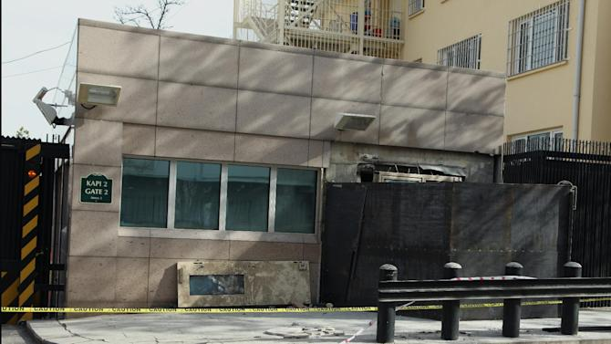 The side entrance of the U. S. embassy, closed with metal sheeting, three days after a suicide bomber attack, in Ankara, Turkey, Monday, Feb. 4, 2013. The suicide bomber who struck the U.S. Embassy in Ankara spent five years in prison on terrorism charges but was released after being diagnosed with a hunger strike-related brain disorder, officials said Saturday. The bomber, identified as 40-year-old leftist militant Ecevit Sanli, killed himself and a Turkish security guard on Friday, in what U.S. officials said was a terrorist attack. (AP Photo/Burhan Ozbilici)