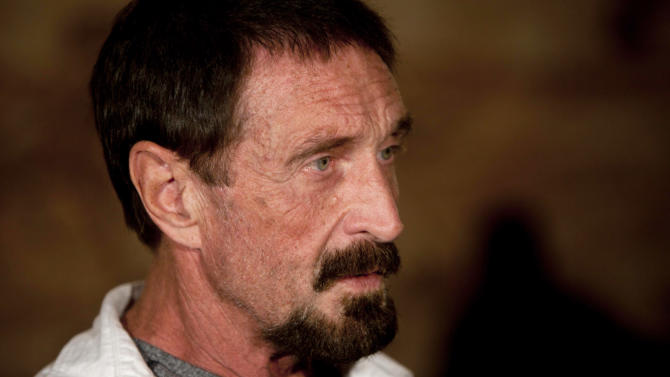 "FILE - In this Dec. 4, 2012, file photo, software company founder John McAfee listens to a question during an interview at a local restaurant in Guatemala City.  McAfee said Sunday, Dec. 9, 2012, a live-stream Internet broadcast from the Guatemalan detention center where he is fighting a government order that he be returned to Belize, that he wants to return to the United States and ""settle down to whatever normal life"" he can. Police in neighboring Belize want to question McAfee in the fatal shooting of a U.S. expatriate who lived near his home on a Belizean island in November. (AP Photo/Moises Castillo, File)"