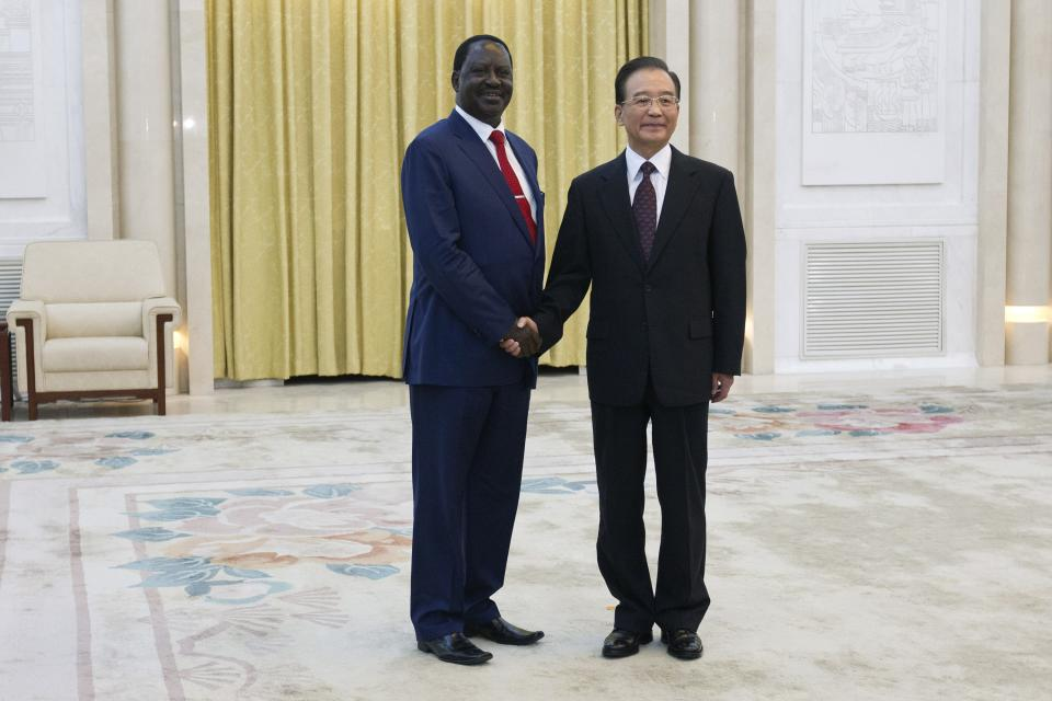 Chinese Premier Wen Jiabao, right, shakes hands with Kenyan Prime Minister Raila Odinga during their meeting at the Great Hall of the People in Beijing, China, Wednesday, July 18, 2012. (AP Photo/Alexander F. Yuan, Pool)