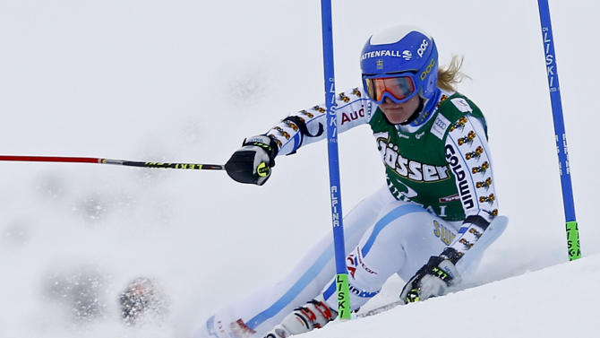 Lindell-Vikarby from Sweden clears a gate during the first run of the World Cup Women's Giant Slalom race in Kuehtai ski resort