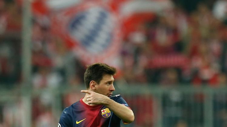 Barcelona's Lionel Messi, from Argentina, leaves the pitch at the end of the Champions League semifinal first leg soccer match between Bayern Munich and FC Barcelona in Munich, Germany, Tuesday, April 23, 2013. Bayern defeated Barcelona 4-0. (AP Photo/Matthias Schrader)