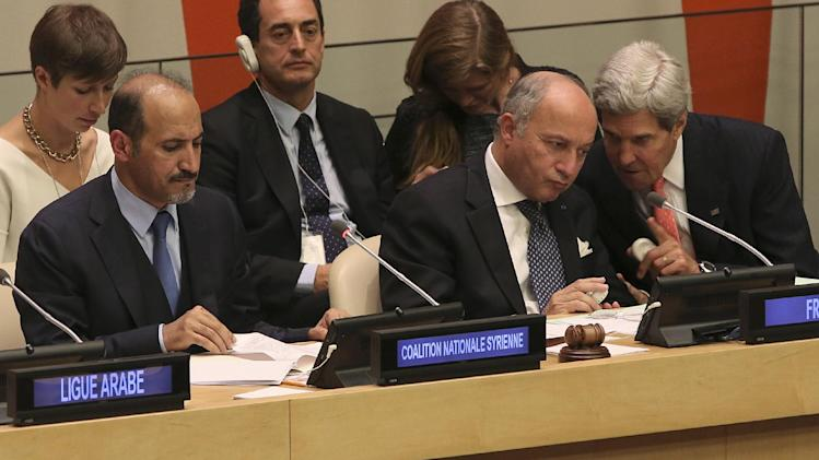 President of the Opposition Syrian Coalition, Ahmad Jarba, left, French Foreign Minister Laurent Fabius, center, and American Secretary of State John Kerry attend a Ministerial Meeting of the Group of Friends of the Syrian people, Thursday, Sept. 26, 2013 at United Nations headquarters. (AP Photo/Mary Altaffer)