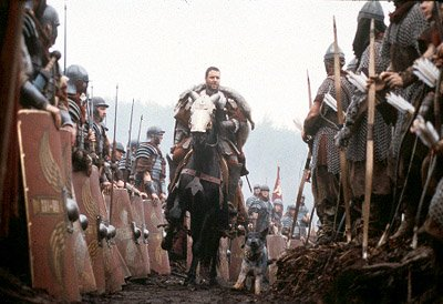 The great Roman General Maximus ( Russell Crowe ) is honored by the Roman Legions under his command as he rides into battle against Germania in Dreamworks' Gladiator