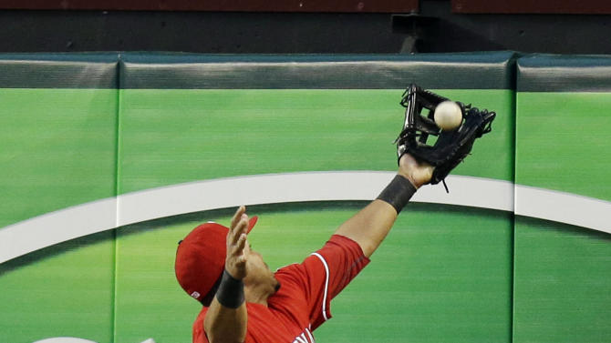 Texas Rangers right fielder Nelson Cruz makes a leaping catch for a fly out against Tampa Bay Rays' James Loney during the first second inning of a baseball game, Monday, April 8, 2013, in Arlington, Texas. (AP Photo/LM Otero)