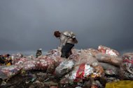 "A youth looks for items to recycle at a garbage dump near the Yemeni capital Sanaa, May 9. Seven aid groups on Wednesday warned Western diplomats that Yemen was on the brink of a ""catastrophic food crisis"" and urged them to bolster efforts to salvage the situation as they meet in Riyadh for an international conference to help the nation"