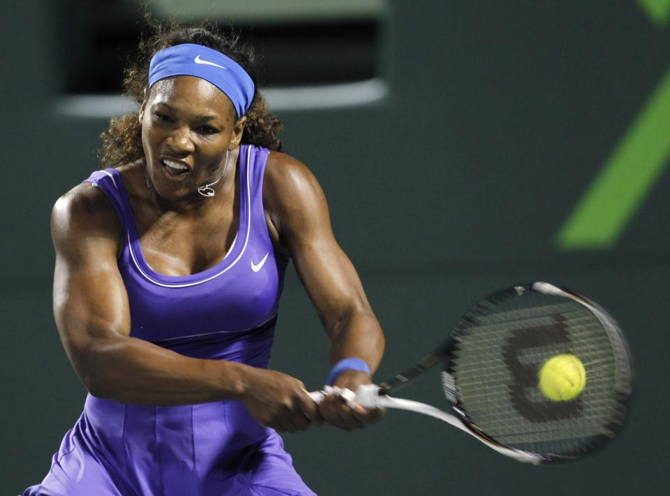 Serena Williams, of the United States, returns to Caroline Wozniacki, of Denmark, during the Sony Ericsson Open tennis tournament in Key Biscayne, Fla., Tuesday, March 27, 2012. (AP Photo/Alan Diaz)