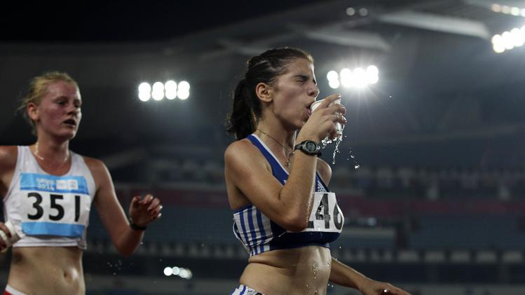 Poland's Niedzialek and Greece's Vaitsi compete during the women's 5,000m race walk at the 2014 Nanjing Youth Olympic Games in Nanjing