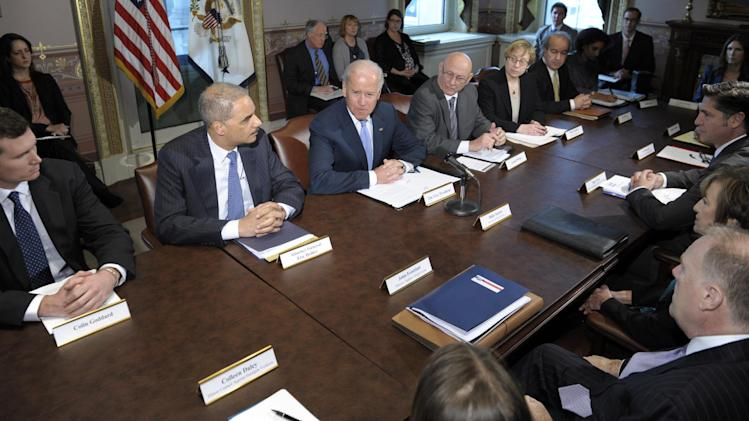Vice President Joe Biden, center, with Attorney General Eric Holder at left, speaks during a meeting with victims' groups and gun safety organizations in the Eisenhower Executive Office Building on the White House complex in Washington, Wednesday, Jan. 9, 2013. Biden is holding a series of meetings this week as part of the effort he is leading to develop policy proposals in response to the Newtown, Conn., school shooting (AP Photo/Susan Walsh)