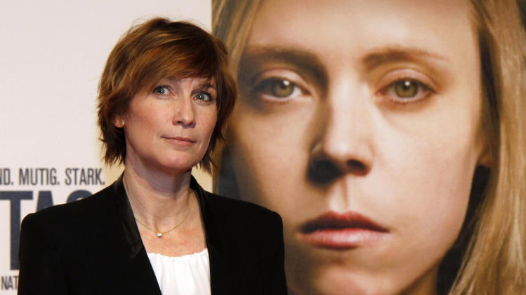 """Director Sherry Hormann poses for photographers before the premiere of the film """"3096 Days"""" in Vienna, Austria, Monday Feb. 25, 2013.  The film tells the story of Natascha Kampusch who was abducted as a schoolgirl and held prisoner in a cellar for almost nine years. (AP Photo/Ronald Zak)"""