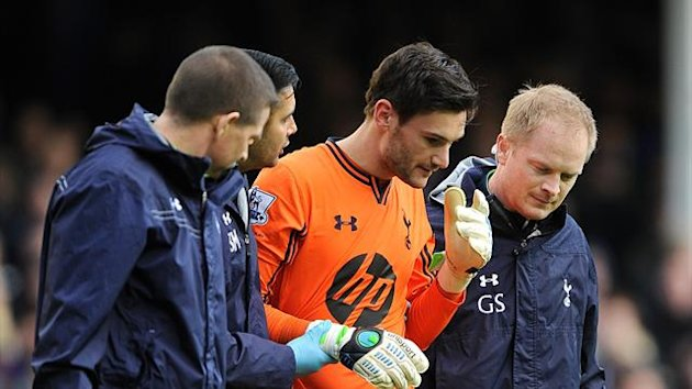 Tottenham;s medical staff assess Hugo Loris (PA)