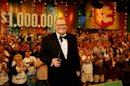 """HOLD FOR LYNN ELBER STORY/PERMISSION - FILE - In this February 2008 publicity image released by CBS Entertainment, host Drew Carey hosts pauses during a taping of of """"The Price is Right Million Dollar Spectacular,"""" one of six new specials to be broadcast on Fridays, beginning Feb. 22, 2008, on the CBS Television Network. A Los Angeles jury says a former model on """"The Price is Right"""" was discriminated against by producers because of her pregnancy. The Superior Court jury awarded nearly $777,000 to Brandi Cochran on Tuesday, Nov. 20, 2012. (AP Photo/CBS, Monty Brinton, File) ** MANDATORY CREDIT. NO ARCHIVE. NO SALES. NORTH AMERICA USE ONLY. **"""