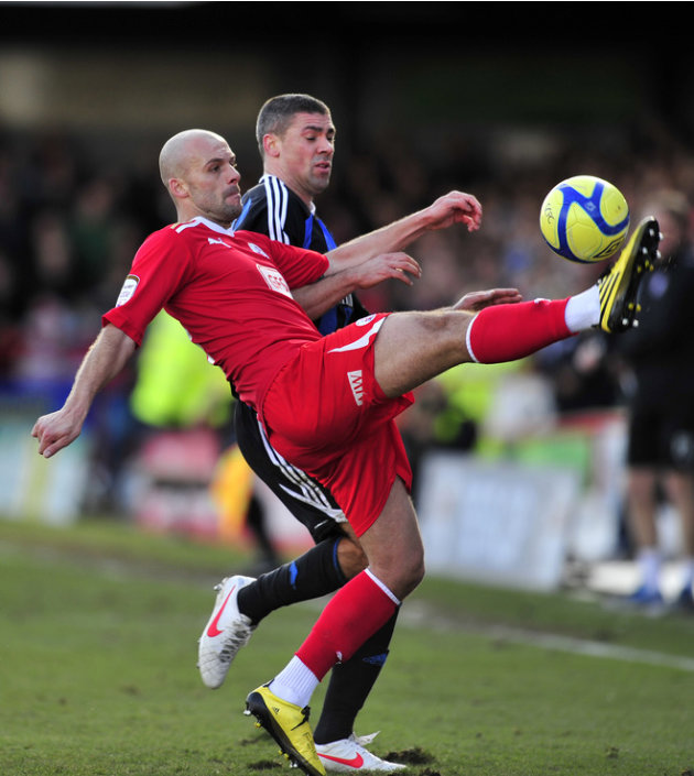 Crawley Town's English Midfielder David Hunt (L) Vies With Stoke City's Republic Of Ireland Striker Jonathan Walters (R) AFP/Getty Images