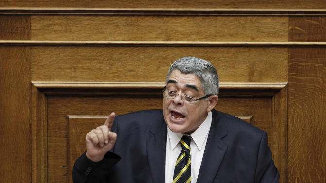 Leader of the extreme right-wing Golden Dawn party Nikolaos Michaloliakos speaks at the Parliament in Athens, Saturday, July 7, 2012. (AP Photo/Kostas Tsironis)