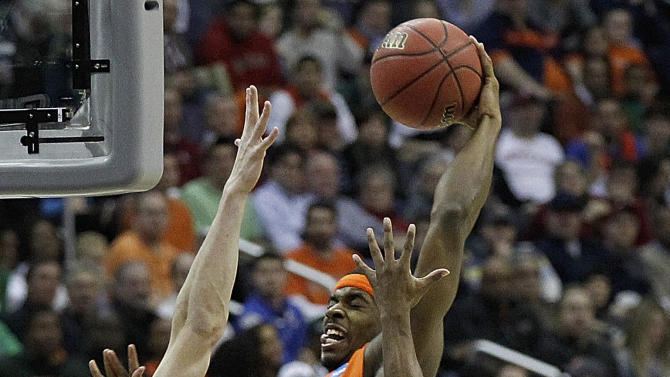 Syracuse forward C.J. Fair (5) heads toward the basket under pressure from Indiana forward Cody Zeller (40) and guard Yogi Ferrell (11) during the first half of an East Regional semifinal in the NCAA college basketball tournament, Thursday, March 28, 2013, in Washington. (AP Photo/Alex Brandon)