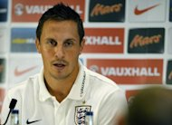 England defender Phil Jagielka speaks during a press conference at the St George's Park training complex, near Burton-upon-Trent, central England on October 8, 2013