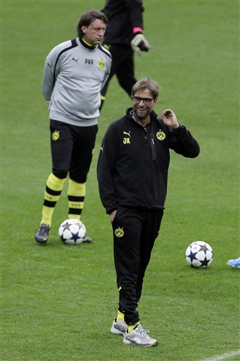 Dortmund head coach Juergen Klopp, right, smiles during a training session at Wembley Stadium in London, Friday May 24, 2013. Dortmund will face fellow German soccer team Bayern Munich in the final of
