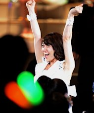 Yuko Oshima of AKB48 celebrates her victory at the AKB48 General Election in Tokyo on June 6. Hundreds of hours of television coverage culminated in a live special with millions tuning in nationwide to see Oshima crowned