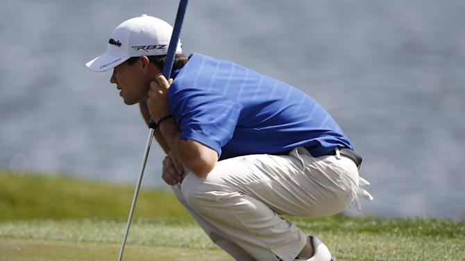Brian Harman lines up a putt on the 18th green the second round of the Honda Classic golf tournament in Palm Beach Gardens, Fla., Friday, March 2, 2012. Harman is 6-under-par after two rounds. (AP Photo/Lynne Sladky)