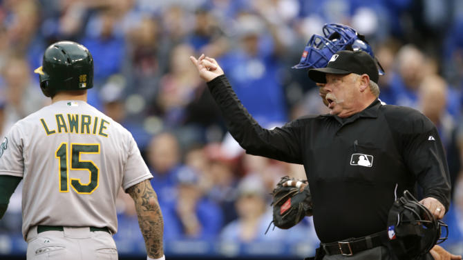 Umpire Jim Joyce, right, ejects Kansas City Royals starting pitcher Yordano Ventura from a baseball game during the fourth inning after hitting Oakland Athletics' Brett Lawrie (15) with a pitch at Kauffman Stadium in Kansas City, Mo., Saturday, April 18, 2015. (AP Photo/Orlin Wagner)