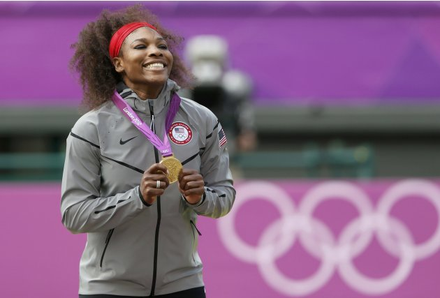 Gold medallist Serena Williams of the U.S. poses after winning the women's singles gold medal match against Russia's Sharapova at the All England Lawn Tennis Club during the London 2012 Olympic Games