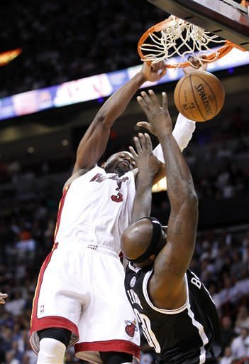 Wade, James lift Heat past Nets, 103-73