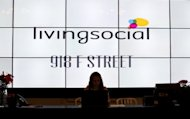 "View of the reception desk at Living Social in Washington on June 26. Living Social is battling sector leader Groupon by offering what executives call ""unique"" or original experiences that are not simply linked to discounts, and has 67 million subscribers in 20 countries"
