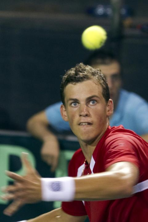 Canadian tennis player Vasek Pospisil returns the ball to Israel's Amir Weintraub during their Davis Cup World Group play-off tennis match on September 18, 2011 at the Canada stadium in Ramat Hasharon