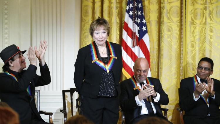 MacLaine is applauded by her fellow 2013 Kennedy Center Honors recipients during a reception at the White House in Washington