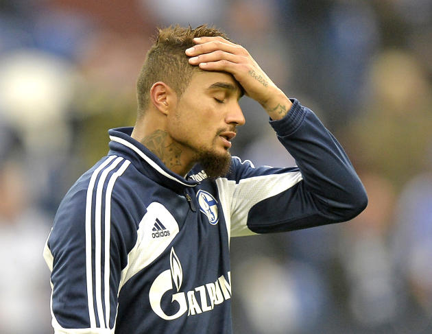 Schalke's Kevin-Prince Boateng reacts after losing the German Bundesliga soccer  match between FC Schalke 04 and Borussia Dortmund in Gelsenkirchen, Germany, Saturday, Oct. 26, 2013. Schalke was defea