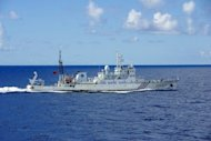 A Chinese marine surveillance ship cruises near the Senkaku/Diaoyu islands in the East China Sea, September 14, 2012. Chinese government ships have re-entered the disputed waters around the islands for the second straight day, Japanese coastguards said