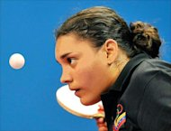 Fabiola Ramos of Venezuela plays against Judy Long of Canada during the Women's single table tennis preliminary round of the 2008 Beijing Olympic Games at the Peking University gymnasium in Beijing on August 18, 2008. Fabiola Ramos won 4 - 1. AFP PHOTO / TEH Eng Koon