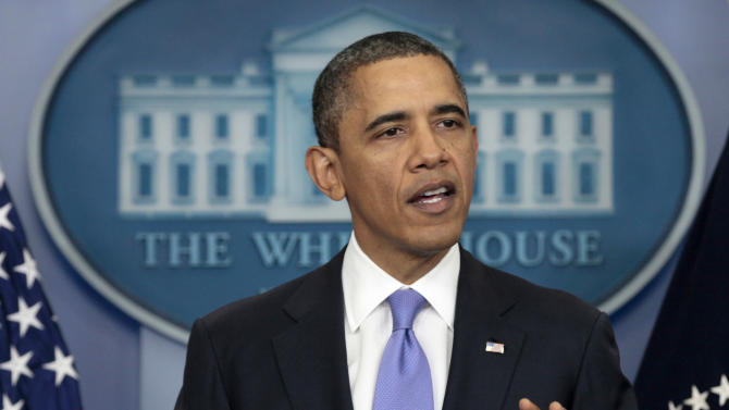 President Barack Obama gestures during a news conference, Thursday, Dec. 8, 2011, in the White House briefing room in Washington. (AP Photo/Carolyn Kaster)