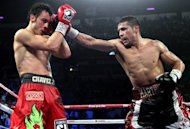 Sergio Martinez (R) throws a right at Julio Cesar Chavez Jr. during their WBC middleweight title fight on September 15. Martinez survived a late knockdown to reclaim the belt when he defeated Chavez Jr. by a unanimous points decision