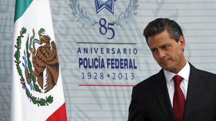 Mexico's President Enrique Pena Nieto attends a ceremony marking the anniversary of the federal police at the federal police intelligence center in Mexico City, Friday, July 12, 2013. (AP Photo/Marco Ugarte)