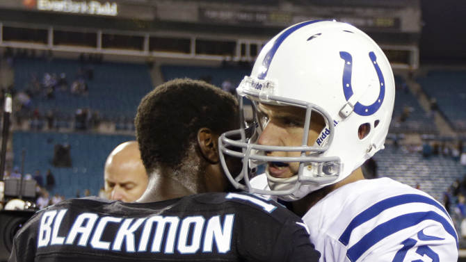 Indianapolis Colts quarterback Andrew Luck (12) hugs Jacksonville Jaguars wide receiver Justin Blackmon (14) after the Colts' 27-10 win in an NFL football game, Thursday, Nov. 8, 2012, in Jacksonville, Fla. (AP Photo/Chris O'Meara)