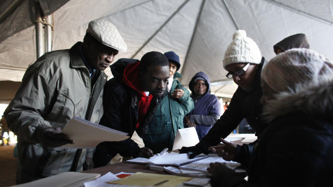 Voters check in before casting their ballots under a tent at a consolidated polling station for residents of the Rockaways on Election Day, Tuesday, Nov. 6, 2012, in the Queens borough of New York. Election Day turnout was heavy in several storm-ravaged areas in New York and New Jersey, with many voters expressing relief and even elation at being able to vote at all, considering the devastation.  (AP Photo/Jason DeCrow)
