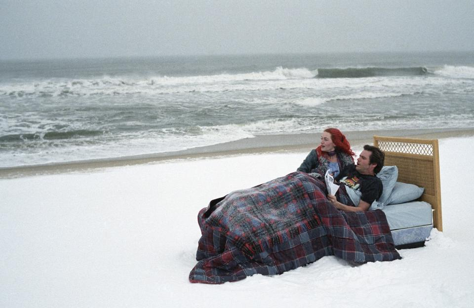"FILE - In this undated promotional file photo released by Focus Features, actors Kate Winslet, left, and Jim Carrey are seen in a scene from the film ""Eternal Sunshine of the Spotless Mind."" (AP Photo/Focus Features, David Lee, File)"