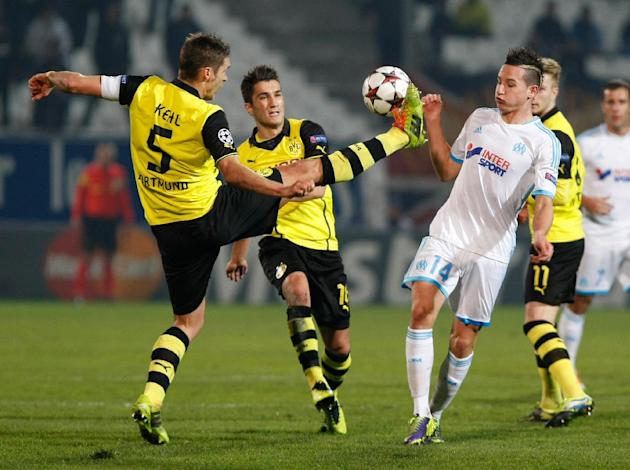 Dortmund's Sebastian Kehl, left, kicks the ball in front of Marseille's Florian Thauvin, right, during the Group F Champions League soccer match between Olympique Marseille and Borussia Dortmu